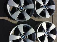 Set of 4 stock wheels off of a 2006 530XI.  One of