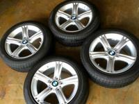 Four (4) BMW original factory Wheels and Tires. Removed