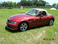 2 door convertible,burgandy w/tan leather interior,all