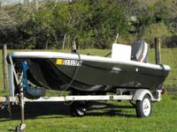 16 ft tom boy bass boat has a fish depth finder,
