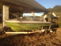 White and green retro boat in good shape. 1984 90hp