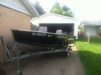 14 ft. Smokercraft fishing boat for sale. Has a 9.9 4