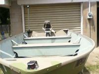 ---- 15 ft by 63 wide aluminum jon boat with a 25
