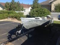 Good sturdy little boat,motor and trailer . Registered