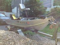This is a 1995 aluminum Lowe boat with platform. 12