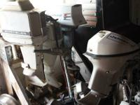 A number of boat motors for sale from little boat to