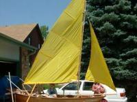 12 foot plywood rowboat with trailer. Can be rigged for