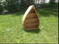 "Boat shaped book shelf. This item stands 42""x 7"" x 17"""