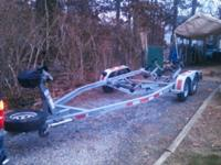 Dual axle boat trailer needs nothing had 23Ft Boat on