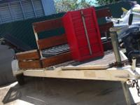 We have this wide, metal/wooden trailer for sale. It is