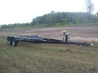 FOR SALE I HAVE A TANDEM AXLE BUNK STYLE BOAT TRAILER