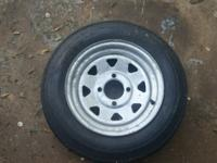 I have a brand new trailer tire and galv. rim for a 4