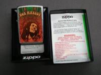 Used Bob Marley Zippo lighter in box. Alpha and numeric