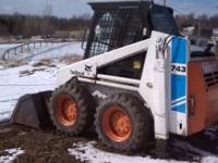 Bobcat skid steer 743 with backhoe attachment.