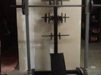 Selling Ironmaster Olynpic weight machine for doing