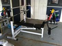 body solid weight bench, weight plates and rack in good