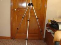Professional- grade tripod for camera or video. Can be