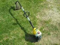 This is a newer Bolens brand string trimmer. Carb