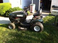 For sale is a Bolens lawn tractor & spreader. 6 speed