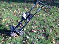 Bolens 2 cycle tiller. Excellent condition. Only used 2