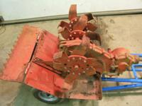 Here is a NEVER used tiller for Bolens tractors-- model