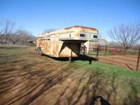 THIS IS A BONANZA 4 HORSE SLANT LOAD TRAILER WITH