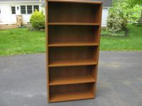 This is a five shelf, oak veneer bookcase that measures