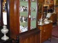 Lovely Book Case has glass front cabinet doors and
