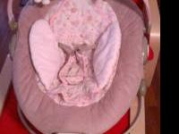 Pink and lt brown Boppy Bounce chair. Asking $15 obo.