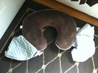 Boppy Pillow with four slipcovers. Gently utilized and