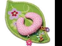 A pink playmat with a small boppy pillow that has toys