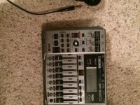 Portable multitrack recorder, Boss BR-900cd.  This is a