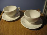 BEAUTIFUL SET OF SAUCERS and cups. DISHES ARE THE IMAGE