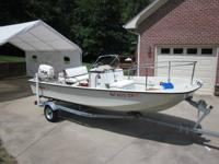 1985 Whaler, 1984 Evinrude 70HP Motor with trim and