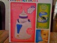 Munchkin bottle and food warmer still in box. the box