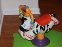Fisher Price Bounce and Spin zebra. lights and music.
