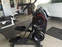 A workout machine similar to an elliptical. Fourteen