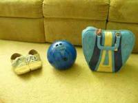 This is a 13# bowling ball for sale. It comes with a