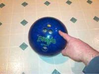 Left handed bowling ball. About 10 lbs. Finger holes