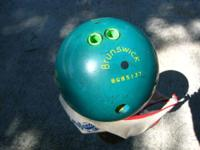 BOWLING BALL, GREEN BRUNSWICK RHINO PRO. Ball is green