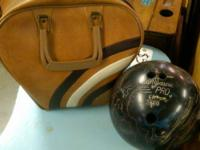 We have a brown bowling ball bag and a black with white