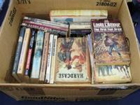 For sale is a box full of old Western books that