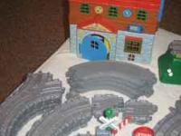Selling a box of Thomas the Train take-a-long trains,