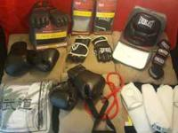 Brand new: 2 Head Gear 2 MMA Gloves -Also includes: 1