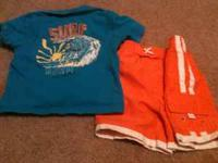 orange swin trunks and blue polo Text  or email