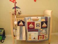 I have a nautical theme crib bedding. Crib bedding is