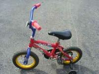 "Huffy ""Rock It"" 12 1/2"" bike with training wheels. Good"
