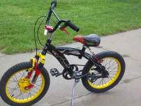 "Red, black and yellow boys 16"" bike in good condition."