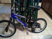 "Kids 16"" Magna bike. Seat adjusts from 20""-25"". Chain,"