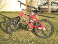 Boys Rocket bike in ok condition. Has a lot of riding